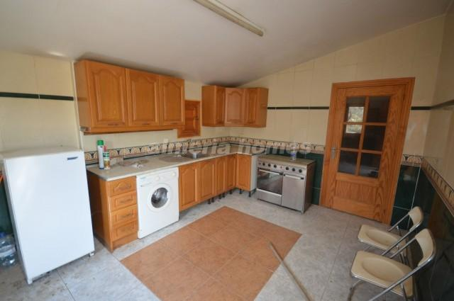 Kitchen on left